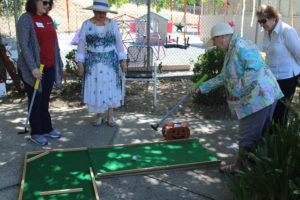 A participant playing a golf game