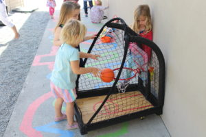 Students at Choice in Learning Montessori playing a basketball game