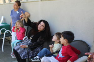 Debbie pointing out something in the sky to students from Choice in Learning Montessori