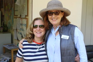 Carol Ann Barber, our Volunteer and Outreach Coordinator, smiling with Peggy Dillon, our Marketing and Outreach Manager