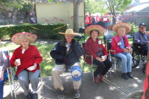 Some participants sitting in the sun with hats