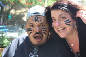 Debbie and a participant showing off their matching facepaint; cat whiskers!