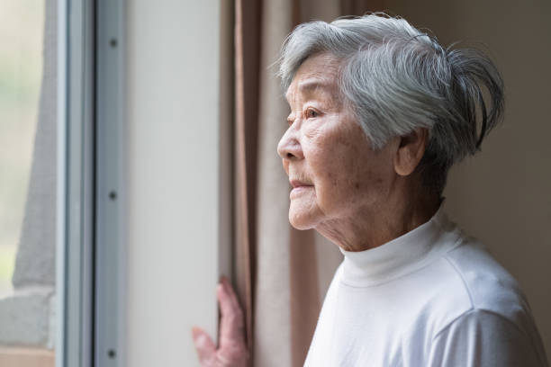 Senior woman looking outside.